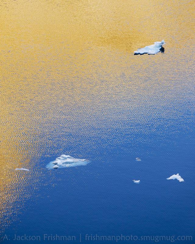 Reflected sunlight and ice in Iceberg Lake, Ansel Adams Wilderness, California, June 2014.